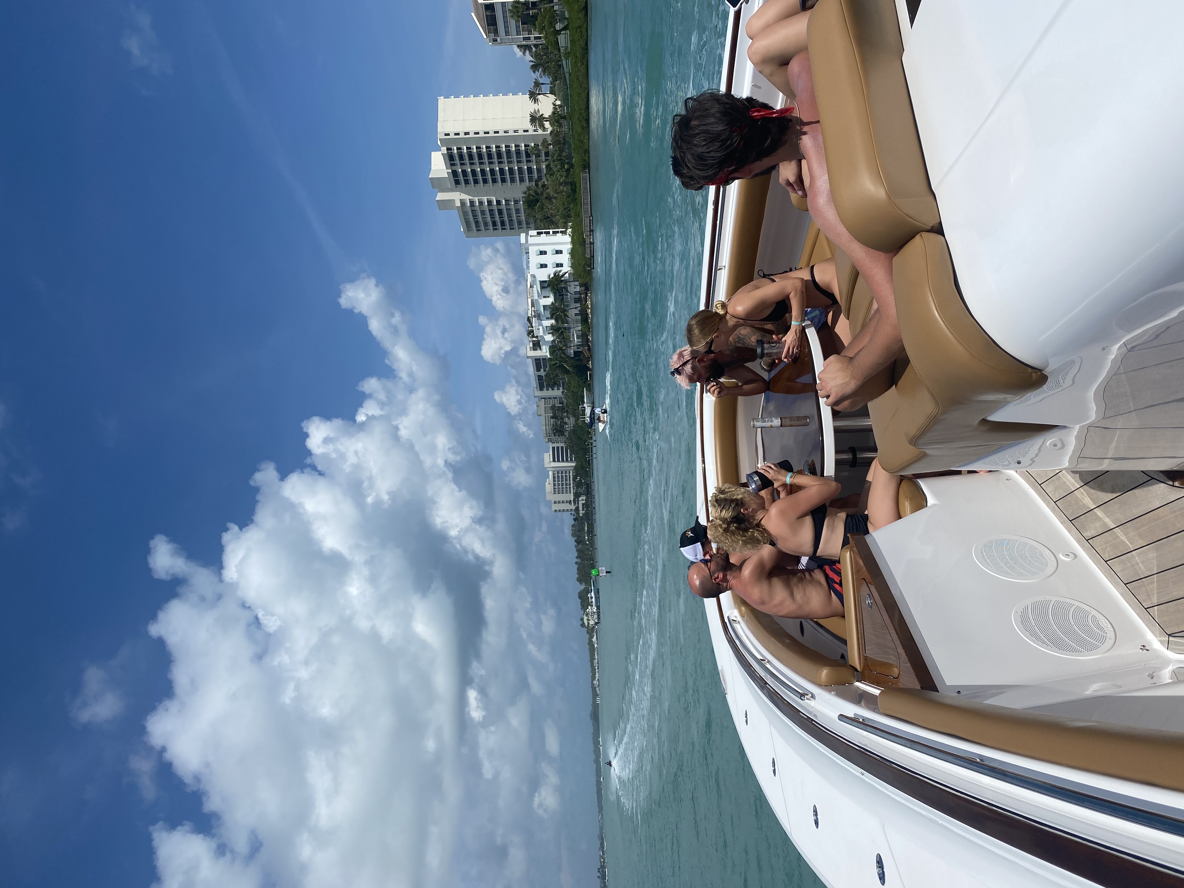 people enjoying bow on charter yacht day trip