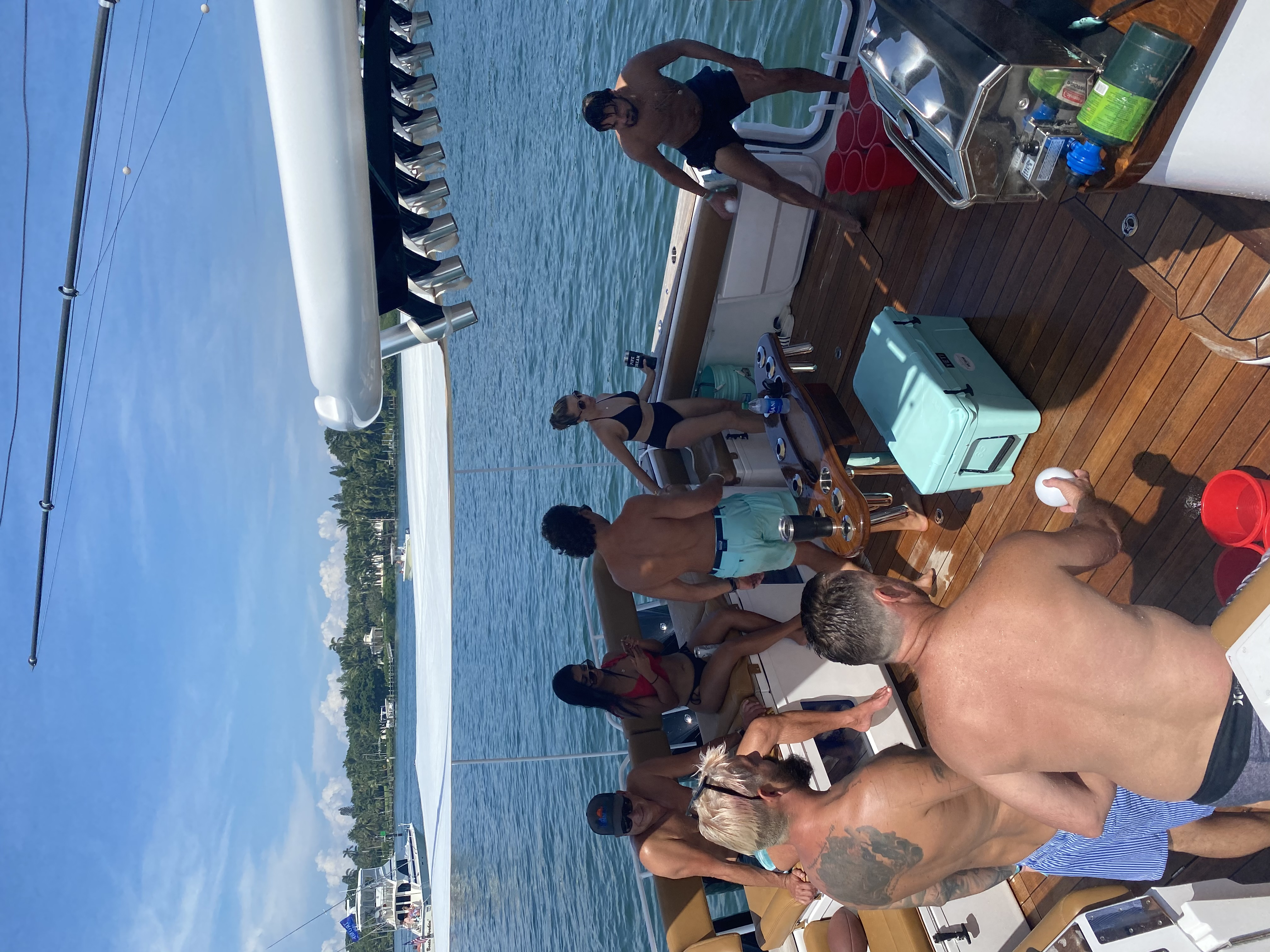 guests partying on charter yacht trip